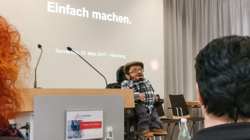 "Raúl Krauthausen holding a keynote titled ""Einfach machen"" (""Simply make it / Make it simple"")"